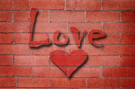 Detail shot of an old red brick wall with Love and heart photo