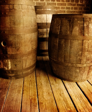 country store: Several old antique wooden wine barrels on plank floor           Stock Photo