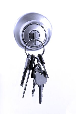door knob: Keys in lock hanging from door knob Stock Photo