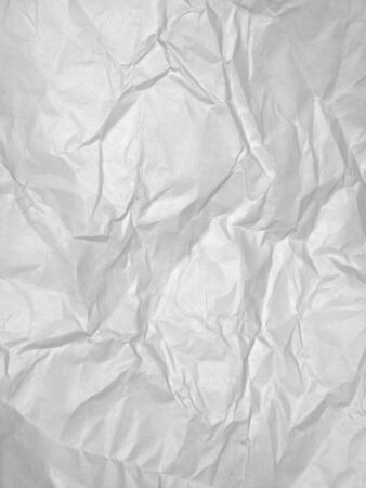 White sheet of crumpled textured paper for a background
