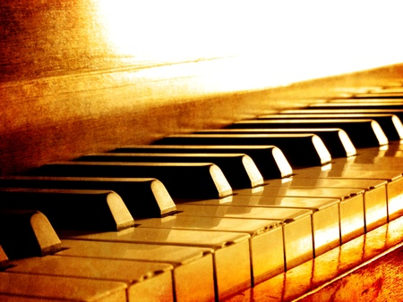 piano: Closeup of black and white piano keys and wood grain with sepia tone Stock Photo