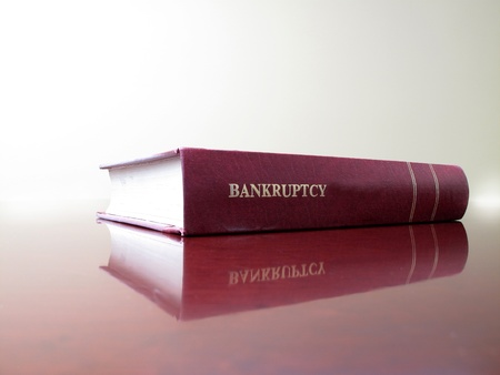 creditor: Close up of an old law book on bankruptcy