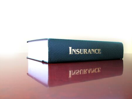 topic: Old leather law book on the topic of insurance Stock Photo