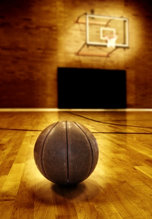 basketball team: Basketball on wooden floor of old basketball court Stock Photo