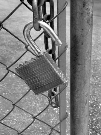 Lock and chain on fence gate illustrating security photo