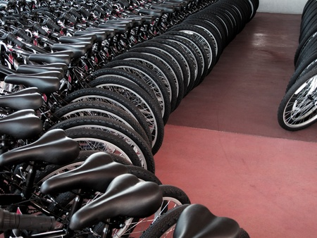 bicycle pedal: Rows of new bikes on showroom floor Stock Photo