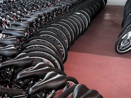 Rows of new bikes on showroom floor Reklamní fotografie