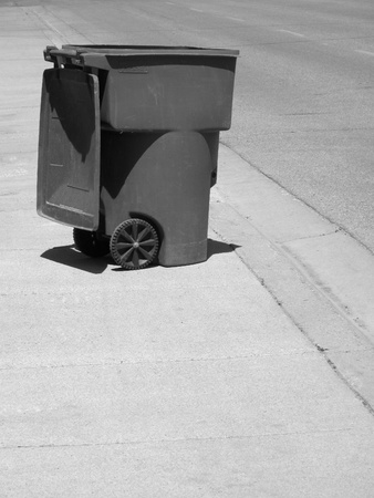 Garbage can on street illustrating pollution and recycling photo