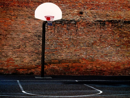 ghetto: Urban basketball court in neighborhood with old buildings