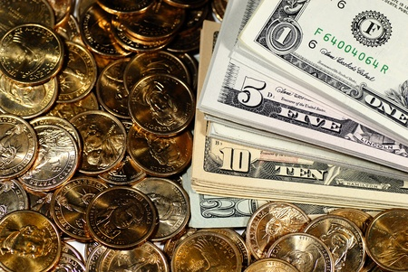 golden coins: Coins and dollar bills representing wealth and savings Stock Photo