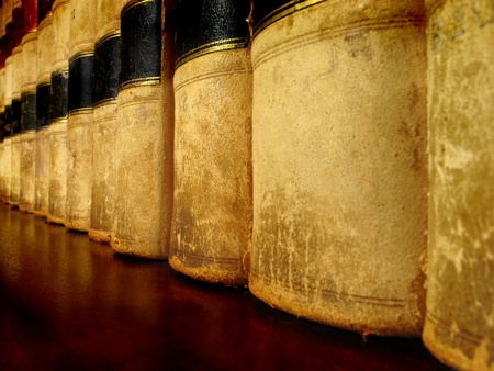 academics: Row of old leather law books on a shelf