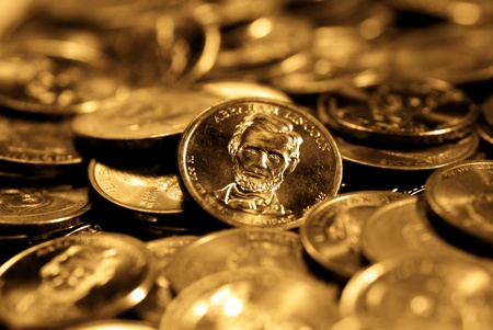 earn money: A pile of golden goins representing wealth and savings