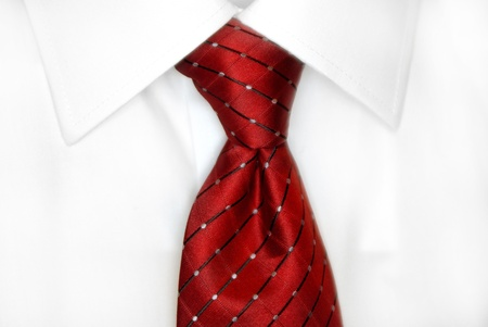 neck ties: White dress shirt with red tie detailed closeup Stock Photo