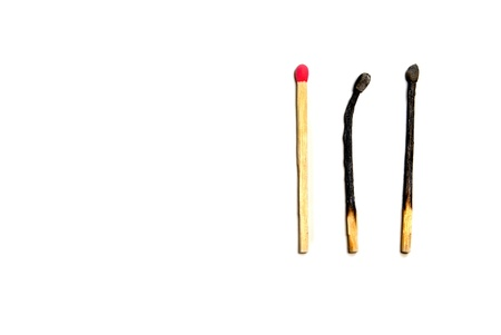 matchstick: Group of Matches with several burned and one not yet lit