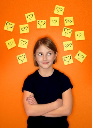 Young girl with sticky notes around her head representing her thoughts photo