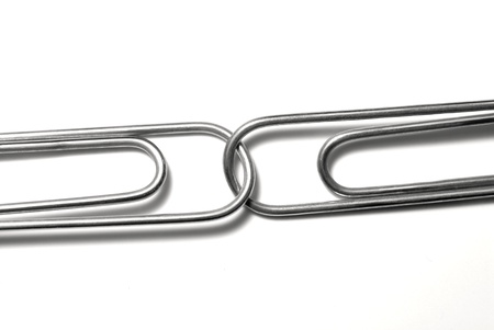 paperclip: Paperclips attached to represent working together and teamwork