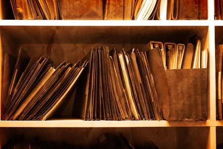 Antique Shelf full of folders and files in an office photo