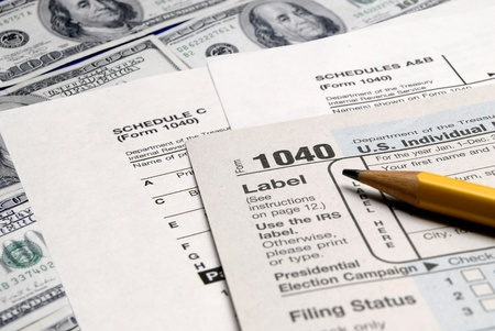 Detail closeup of current tax forms and pencil on money  Stock Photo