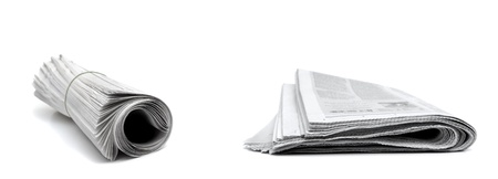 Rolled up newspapers isolated on white background photo