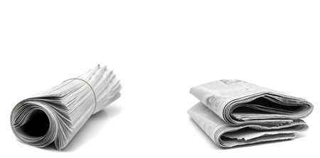 Rolled up newspapers isolated on white background Stock Photo