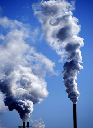 smoke stack: Detail of pollution coming from factory smoke stacks Stock Photo