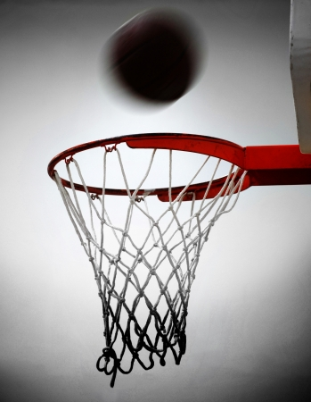 net: Basketball going into hoop and net with white background
