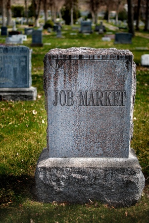 Gravestone in cemetery for job market and employment 免版税图像