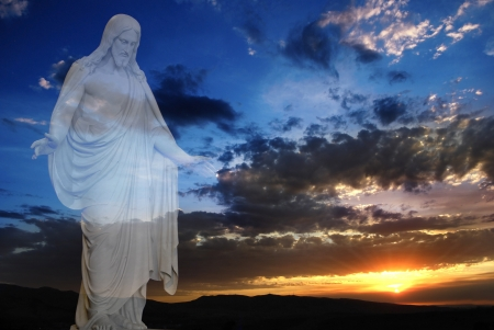 jesus standing: Jesus standing in white and gray storm clouds in blue sky with rays of light at sunset