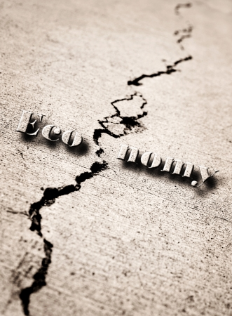 Crack in cement symbolizing a broken economy Stock Photo - 15165457