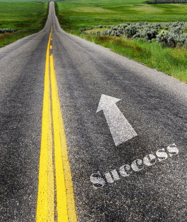 Road to success with painted double yellow lines photo