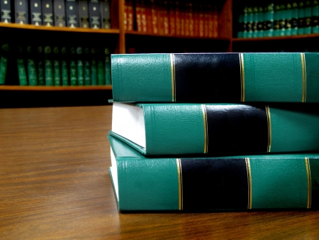 Row of old leather books on a desk or table with blank covers photo