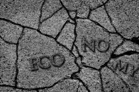 Crack in asphalt symbolizing a broken economy photo