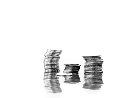 Several stacks of coins isolated on white background with reflections Stock fotó