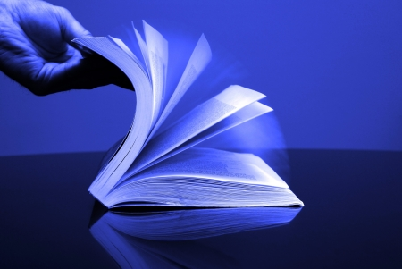 A large single book sitting with pages open on a desk Stock Photo - 15399158