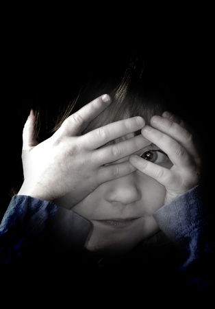 Little girl playing peek a boo with her hands Stock Photo - 15573831