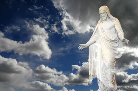 jesus standing: Jesus standing in white and gray storm clouds in blue sky with rays of light