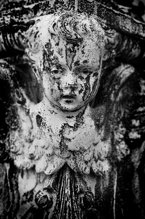 Antique marble statue of a Cherub angel with detail of the face photo