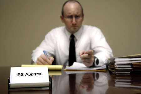 federal tax return: IRS tax auditor man with a stern or mean expression Stock Photo