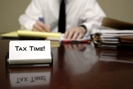 exempt: IRS tax auditor man sitting at desk with business card