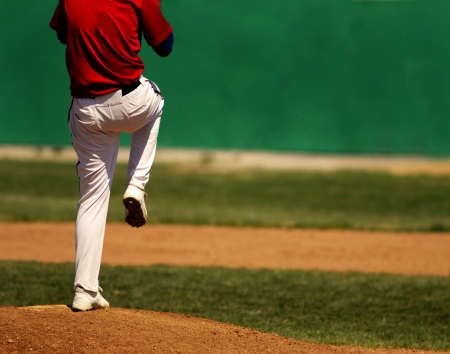 Baseball player wearing uniform throwing baseball Stock fotó - 17381713