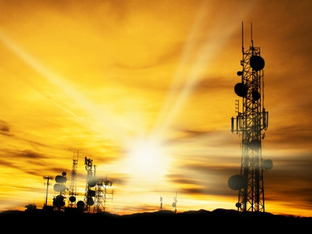 Several radio towers with sunset sky in background          Stock Photo - 17531171