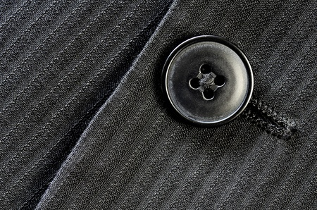 Detail of closeup of suit button on pin stripped cloth Stok Fotoğraf