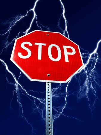 Stop sign with bolts of lightning in background in sky              photo