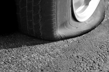 tire: Detail Shot of a Flat Tire on a Car