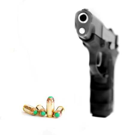 ammunition: Closeup of tactical military bullets and handgun in firing position Stock Photo