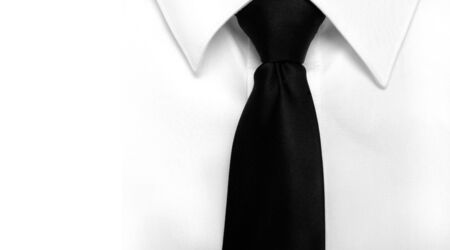 neck tie: Closeup of white shirt and black tie with copy space Stock Photo