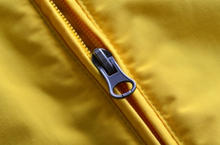 Closeup of zipper on Yellow coat with texture Stock Photo