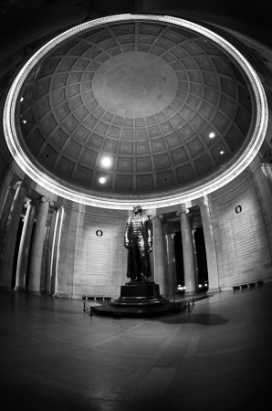 Jefferson Memorial in Washington DC with statue and collumns photo