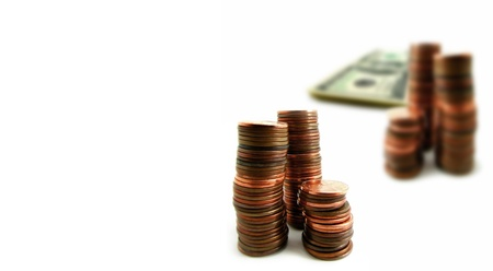 pennies: Several stacks of coins and money isolated on white background