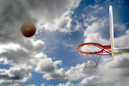 street shots: Outdoor basketball with clouds and sky and shot to the hoop